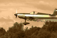 The plane II. The plane is landing. European Aerobatic Championship, Lithuania. Sepia toned Royalty Free Stock Images