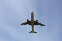 Plane Inflight. Commercial airplane approaching the runway royalty free stock images
