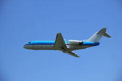 Plane Inflight. Middle size commercial airplane after take off royalty free stock photo