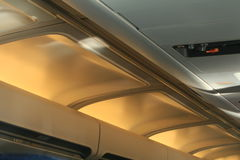 Plane Interior. Lighting in the interior of an aeroplane, personal controls for comfort Royalty Free Stock Photo