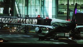 Plane at terminal gate, night view, Munich. Plane jet in Munich Airport, night view. Plane waiting passenger onboarding stock video