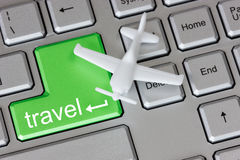 Plane  on keyboard with travel button Stock Images