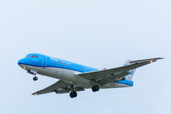 Plane from KLM Cityhopper PH-KZU Fokker F70 is landing at Schiphol Airport. Royalty Free Stock Images