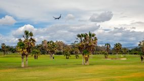 A plane landed over the golf course Royalty Free Stock Photography