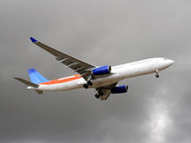 Plane before landing. Aircraft flying in rainy day Royalty Free Stock Photo