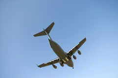 Plane Landing. Transport plane landing with blue sky in the background Stock Images