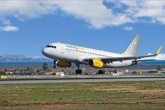 Plane Landing At Airport Stock Photo