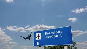 Plane landing in Barcelona. Jet plane landing in Barcelona, Spain, Catalonia. City arrival with airport direction sign. Travel, business, tourism and transport stock video