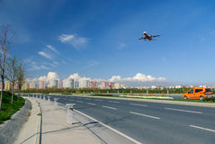 Plane landing with blue sky Stock Photo