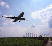 Plane landing. A plane landing at Brussels airport royalty free stock images