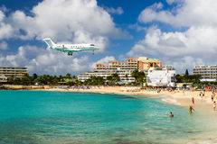 Plane Landing in the Caribbean Royalty Free Stock Photo