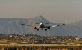 Plane landing at Corfu International Airport. stock photo
