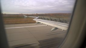 Plane landing. the flaps of the aircraft. Wing of plane. Airplane window. Wing of airplane from window. Airplane flight. Wing of an airplane flying above the stock footage