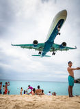 Plane landing flying over famous Maho Beach Royalty Free Stock Photo