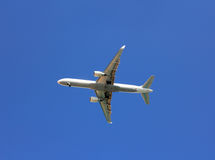 Plane with landing gear. Comes in blue sky Stock Images