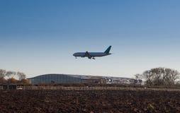 Plane landing at Heathrow near Terminal 5 Stock Photos