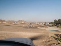 Plane landing at Nazca Royalty Free Stock Image