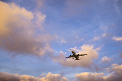 Plane is landing during a nice sunset. In Spain stock images