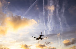 Plane is landing during a nice sunset. In Spain Royalty Free Stock Image