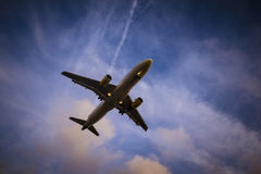 Plane is landing during a nice sunset. In Spain royalty free stock images