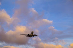 Plane is landing during a nice sunset. In Spain royalty free stock photo