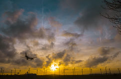 Plane is landing during a nice sunset. In Spain stock photography