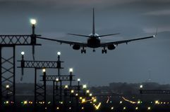 Plane landing at nightfall at an airport in Spain royalty free stock photography