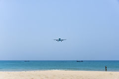 Plane is landing over the beach Stock Photo