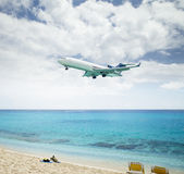 Plane landing over Maho Beach in Saint Martin island Stock Images