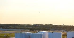 Plane Landing Over Tanks Stock Images