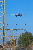 Plane landing. Photograph of a plane landing in El Prat airport, Barcelona, Spain Royalty Free Stock Photo