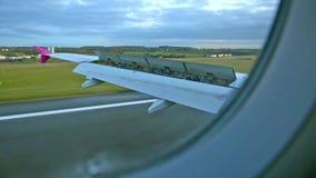 Plane landing on runaway at morning stock footage
