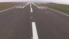 Plane landing and runway lighting stock video footage