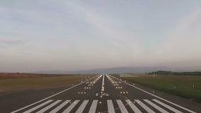 Plane landing and runway lighting stock footage
