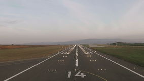 Plane landing and runway lighting stock footage
