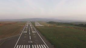 Plane landing and runway lighting stock video