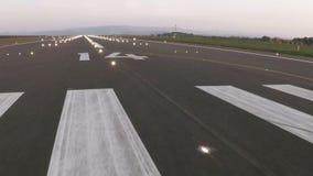 Plane landing and runway lighting Royalty Free Stock Images