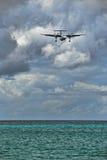 Plane Landing in Saint Maarten Stock Images