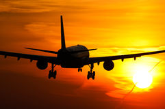 Plane landing in sunrise Royalty Free Stock Images