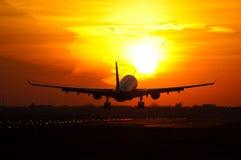 Plane landing in sunrise Royalty Free Stock Photography