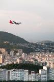 Plane landing at sunset Stock Images