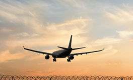 The plane is landing. Sunset in Moscow royalty free stock photo