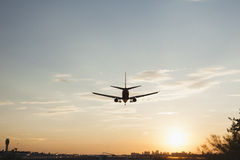 Plane landing with sunsetting Stock Photography