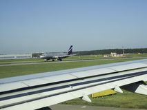 The plane lands on the runway. The aircraft accelerates on the runway Royalty Free Stock Image