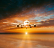 Plane lands on the runway Stock Photography