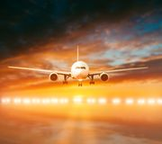 Plane lands on the runway royalty free stock photos