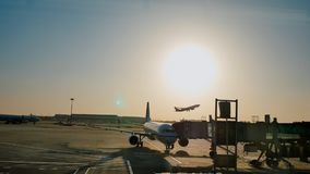 The plane leaves for the runway for the flight. Evening at sunset. Beijing. China. stock photo