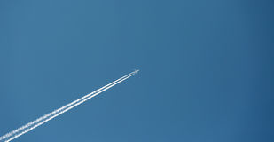 Plane leaves trail Royalty Free Stock Photography