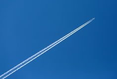 Plane leaves trail Royalty Free Stock Photo