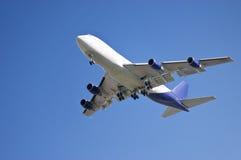 Plane lift-off 1. Big cargo/passengers plane against a blue sky Stock Photo